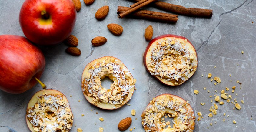 apples cut in circles with almonds and granola