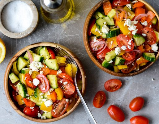 greek salad in bowl with lemon
